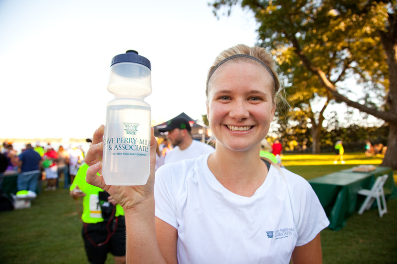 Holly Aldredge shows off the branded water bottles distributed at last year's Tour des Fleurs. (Photo by Ben Marshall)