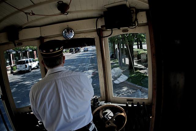 A motorman pilots a trolley down McKinney Avenue. (Photo by Enoch Lai, via Flickr)