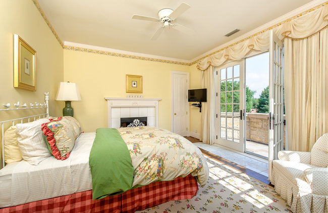 One of the seven bedrooms, all of which are upstairs