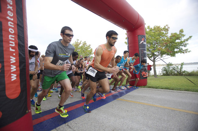 Runners cross the starting line at the Tour des Fleurs on Saturday. (Photos by Chris McGathey)