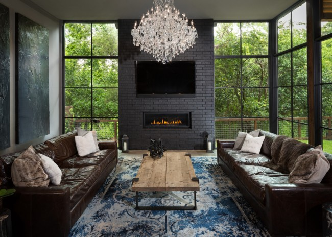 "6723 Sunnyland Ln. - This urban contemporary home was built in 2016 on a cul-de-sac lot overlooking White Rock Creek. The interior is inspired by British designer Timothy Oulton and incorporates dark accents, crystal chandeliers, and polished concrete-and-walnut floors to complete the urban feel of the home. The walls of glass and the multitude of windows bring the outside in and create Lakewood's very own modern Swiss Family Robinson ""tree house"". While the home is glamorous and sophisticated, it is also homey and inviting. Even the family's large Great Dane has her own room, complete with doggie door and custom built-ins. Sponsored by: Nancy Johnson Group and Republic Title Lakewood"