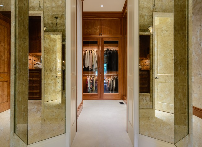 Cherry and glass cabinets in the dressing area and an exercise room help put this master suite over the top.