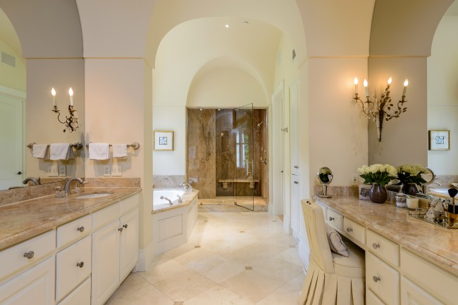 Heated floors, soaring ceilings, marble steam shower and more make this master bath a comforting place to retreat.