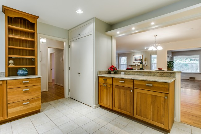 The kitchen has been updated with granite countertops and stainless steel appliances.
